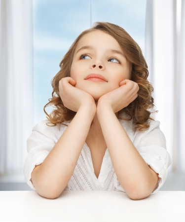 picture of thinking pre-teen girl in casual clothes Stock Photo - 18004930
