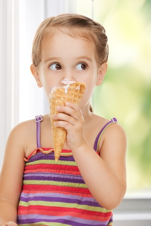 bright picture of beautiful litle girl with ice cream Stock Photo - 18004934