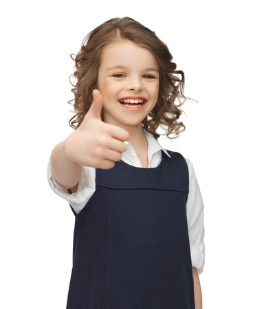 pre school: picture of beautiful pre-teen girl showing thumbs up Stock Photo