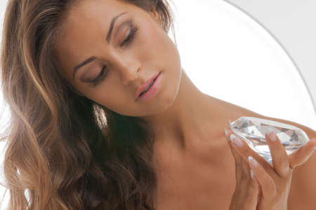 face and hands of beautiful woman with diamond Stock Photo - 18004892