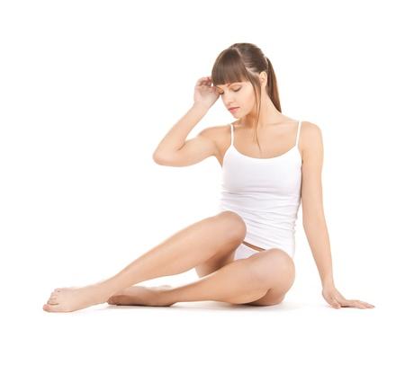 unterwäsche frau: Bild der sch�nen Frau in Unterw�sche aus Baumwolle Lizenzfreie Bilder