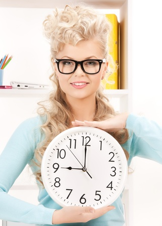 bright picture of attractive businesswoman with clock Stock Photo - 18004928