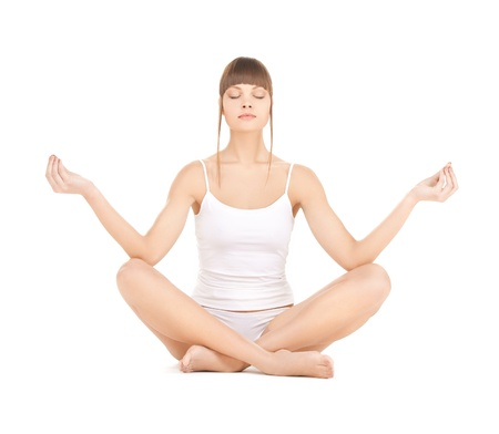 sporty woman in cotton underwear practicing yoga lotus pose photo