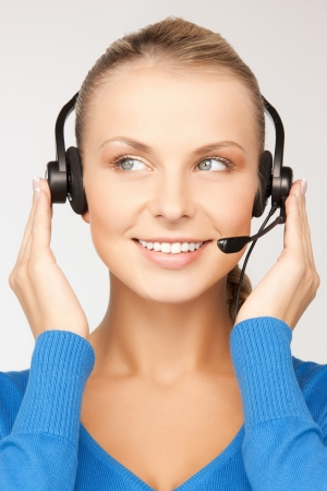 bright picture of friendly female helpline operator Stock Photo - 18004988