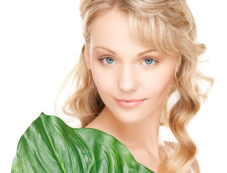 picture of woman with green leaf over white  Stock Photo - 18004935