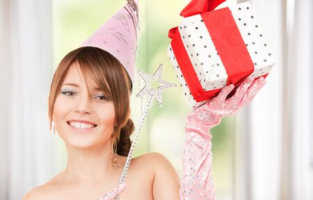 happy teenage party girl with magic wand and gift box Stock Photo - 18004932