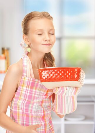 bright picture of cooking girl in the kitchen photo