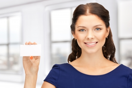 bright picture of confident woman with business card photo