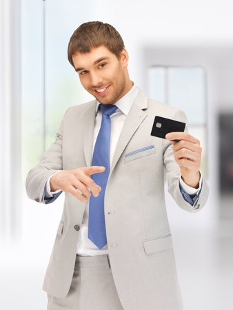 bright picture of happy businessman with credit card Stock Photo - 18004989
