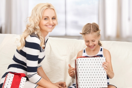 picture of mother and little girl with gifts  Stock Photo - 18004982