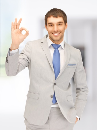 bright picture of handsome man showing ok sign photo