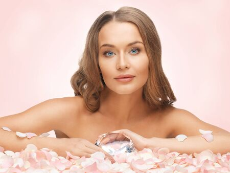 picture of woman with big diamond and rose petals Stock Photo - 18004919