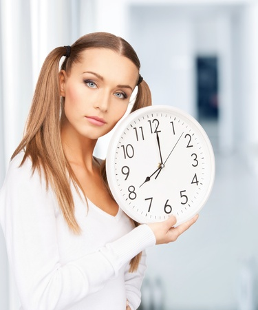 bright picture of woman holding big clock Stock Photo - 18004965