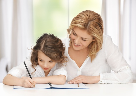 picture of mother and daughter doing home work Stock Photo - 18004962