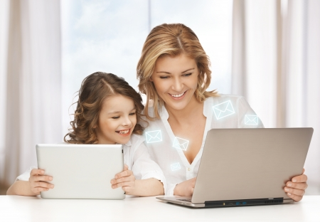 mother and daughter with laptop and tablet pc Stock Photo - 18004931