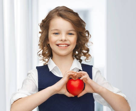 picture of beautiful girl with small heart Stock Photo - 18004987