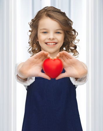 picture of beautiful girl with small heart Stock Photo - 18004985