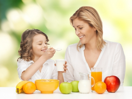 picture of mother and daughter with healthy breakfast Stock Photo - 18004929