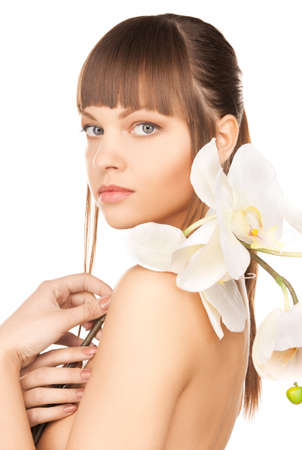 perfect face: bright picture of lovely woman with orchid flower  Stock Photo