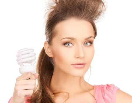 picture of beautiful woman with energy saving bulb photo