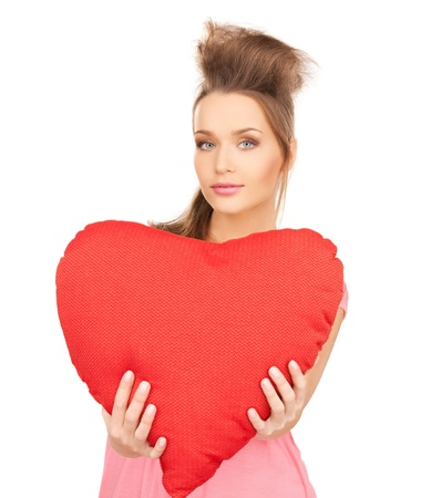 picture of happy and smiling woman with heart-shaped pillow photo