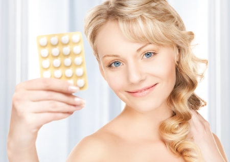 picture of young woman with pills photo