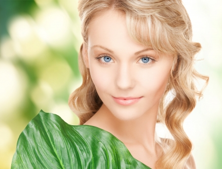 picture of happy woman with green leaf photo