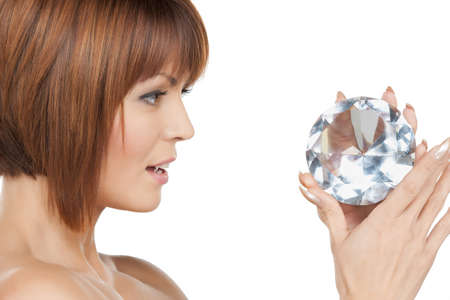 face and hands of beautiful woman with diamond photo