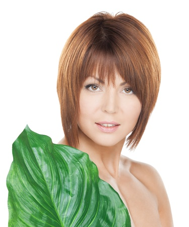bodycare: picture of woman with green leaf over white