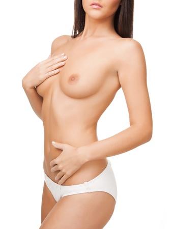 seins nus: Gros plan image lumineuse du corps femme aux seins nus