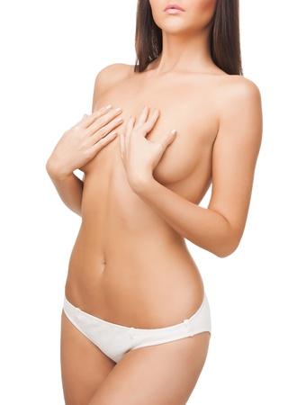 corps femme nue: Gros plan image lumineuse du corps femme aux seins nus