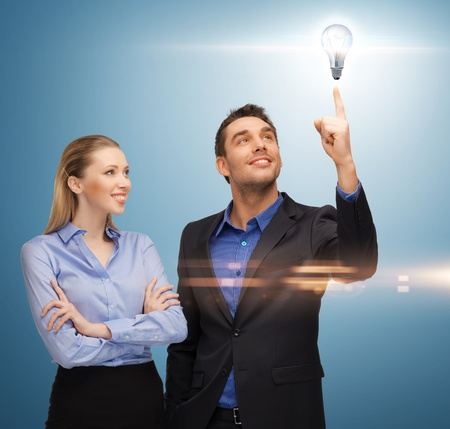 bright picture of man and woman with light bulb photo