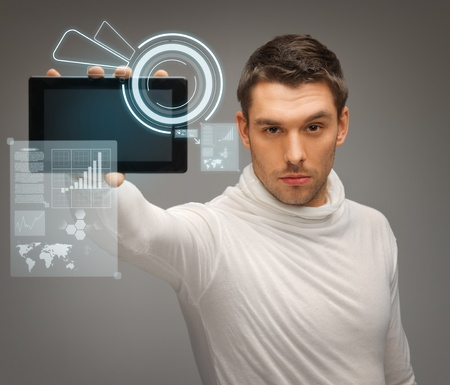future technology: picture of man with tablet pc and virtual screens Stock Photo