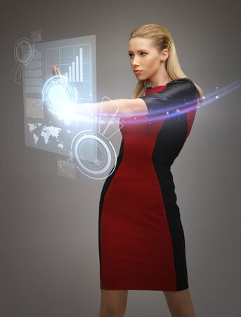 picture of futuristic woman working with virtual touchscreens photo