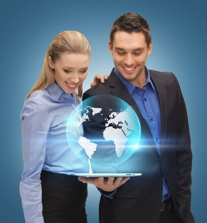 man and woman with virtual globe from tablet pc photo