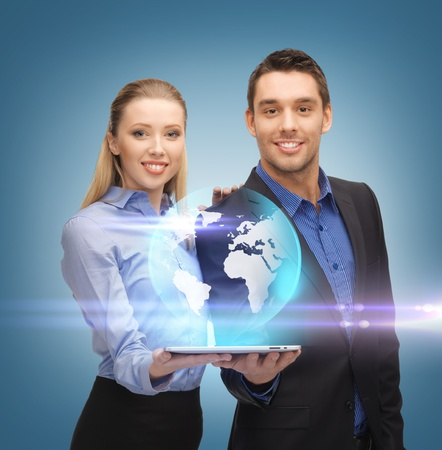 cyber woman: man and woman with virtual globe from tablet pc