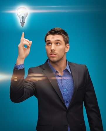 picture of man in suit with light bulb photo
