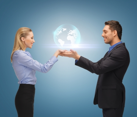 hand holding globe: picture of man and woman showing earth globe on the palms