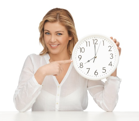 oclock: picture of woman in casual clothes with clock