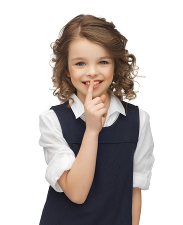 picture of beautiful pre-teen girl showing hush gesture Stock Photo - 18161084