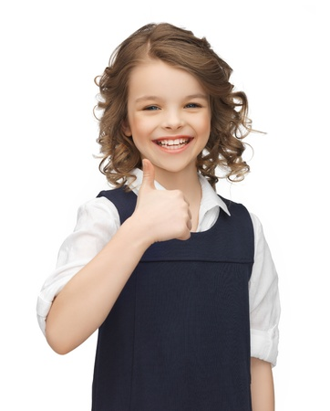 beautiful preteen girl: picture of beautiful pre-teen girl showing thumbs up Stock Photo