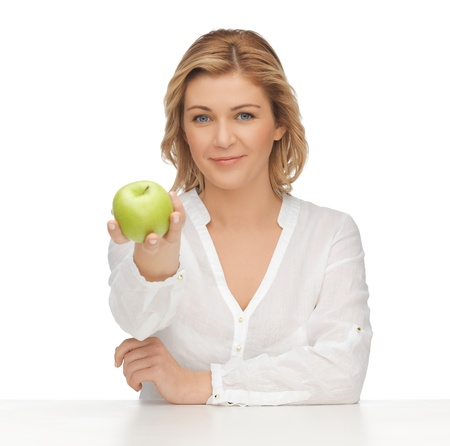 picture of woman in casual clothes with green apple photo