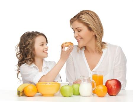 picture of mother and daughter with healthy breakfast photo