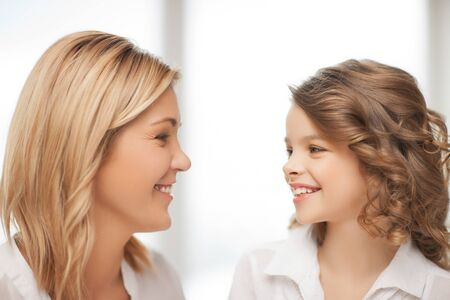 pre teens: bright closeup picture of mother and daughter Stock Photo