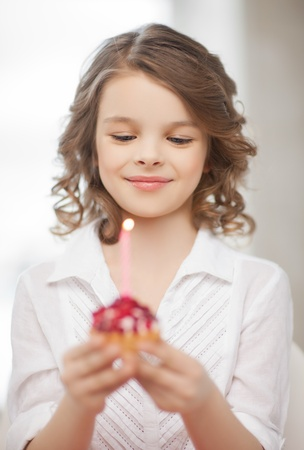 picture of beautiful pre-teen girl with cupcake photo