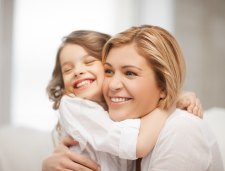 bright picture of hugging mother and daughter photo