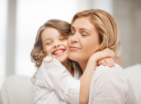 daughter mother: bright picture of hugging mother and daughter Stock Photo