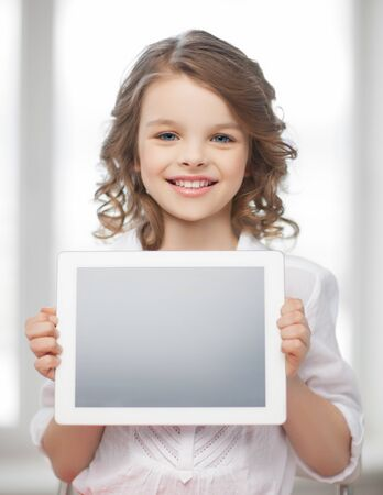 picture of beautiful pre-teen girl with tablet pc photo