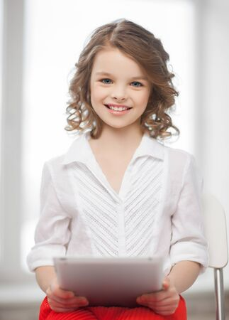 beautiful preteen girl: picture of beautiful pre-teen girl with tablet pc
