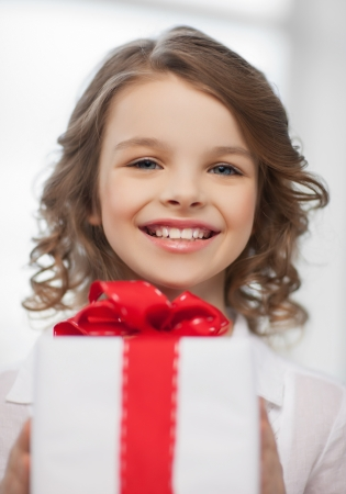 picture of beautiful pre-teen girl with gift box photo